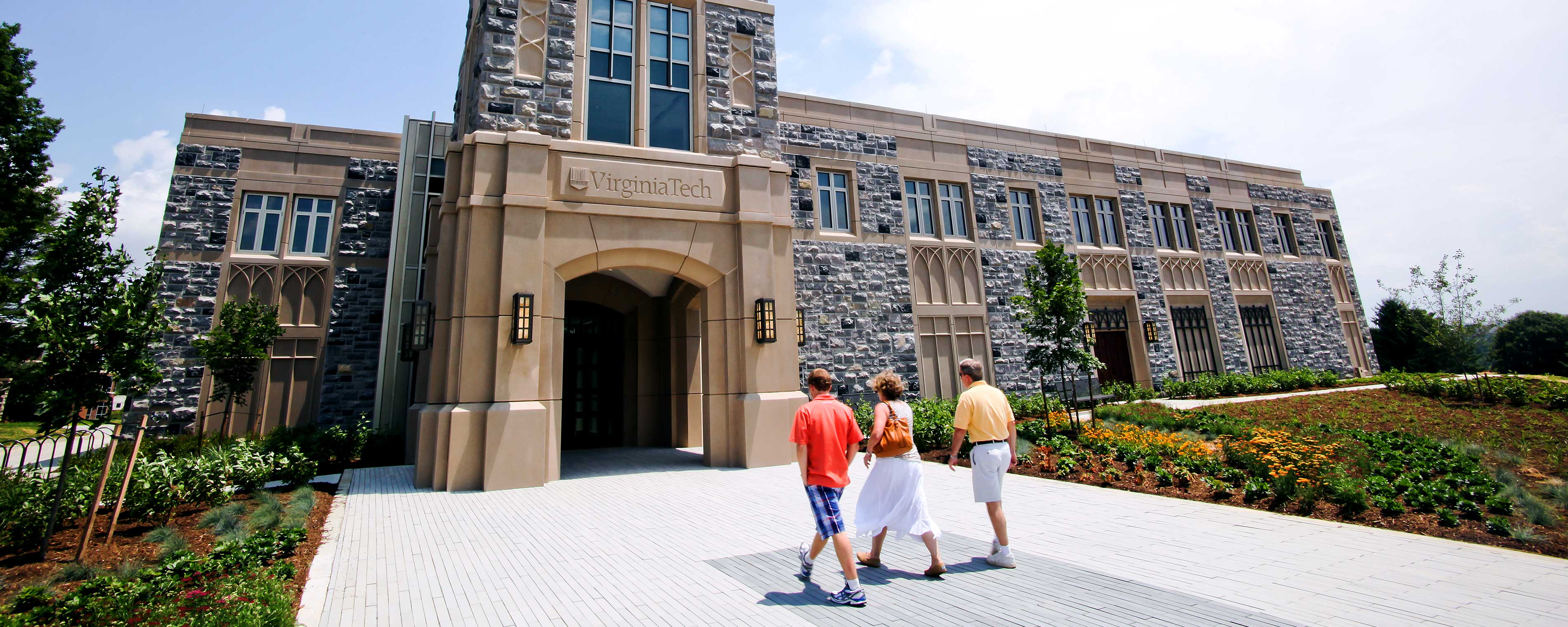 A family walks into the Admissions Building